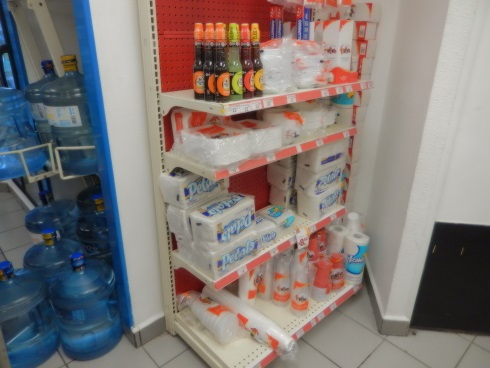 Disposable plates, cups, napkings, wet wipes, diapers at the OXXO convenience store Puerto Aventuras Mexico